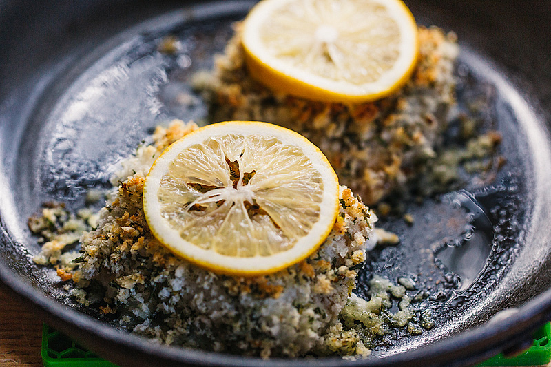 panko crusted cod with lemon slices on top
