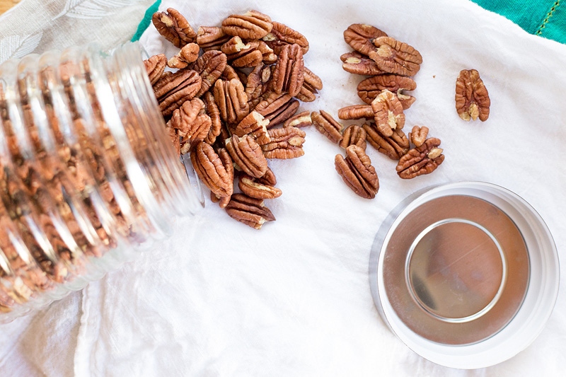 pecans spilling out of a jar