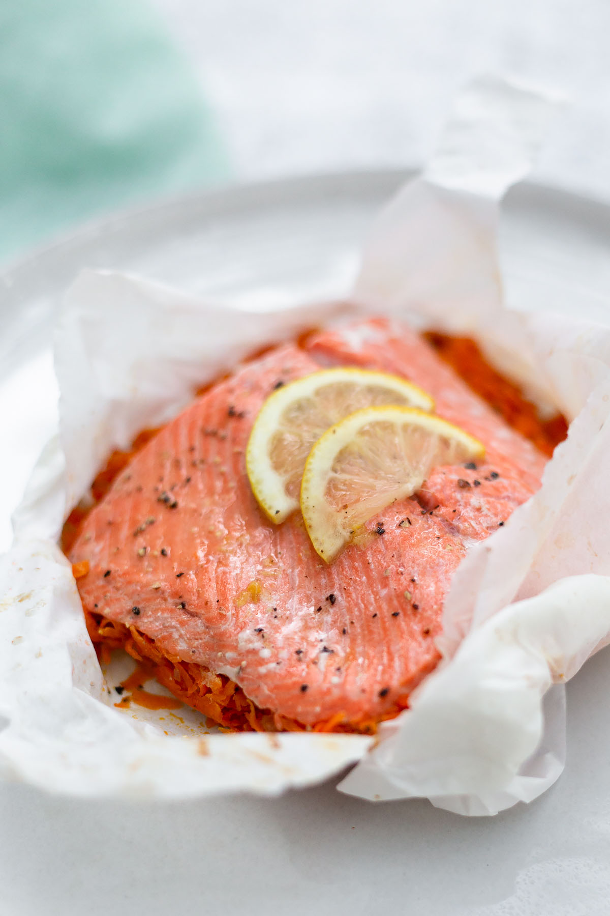 salmon in parchment up close with lemon slices