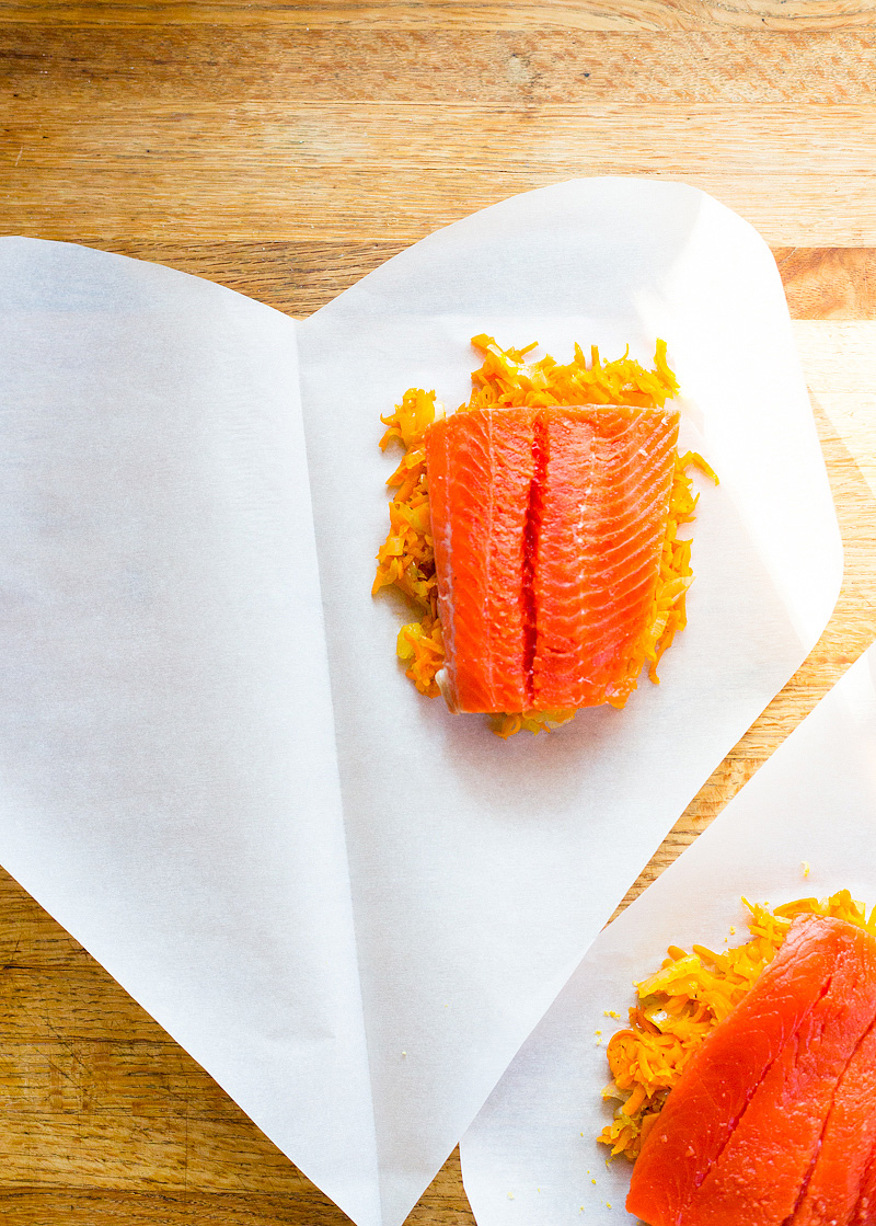 uncooked salmon in parchment paper hearts