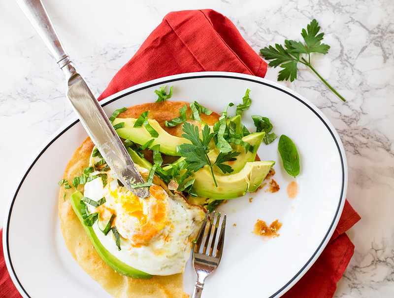 breakfast tostada with avocado and egg