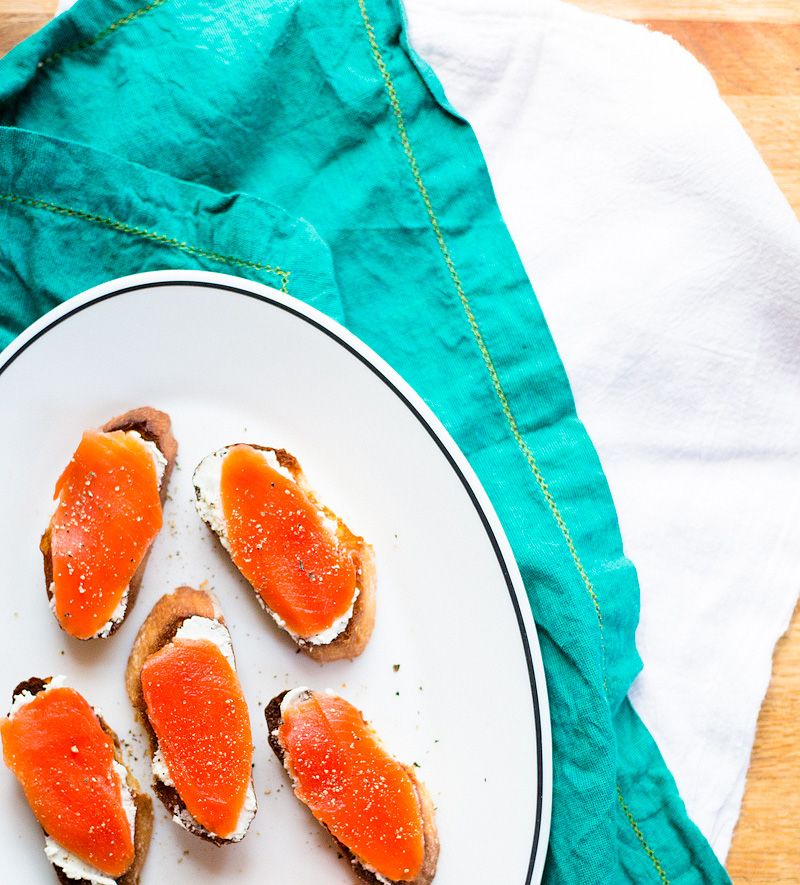 salmon and goat cheese crostini on a plate