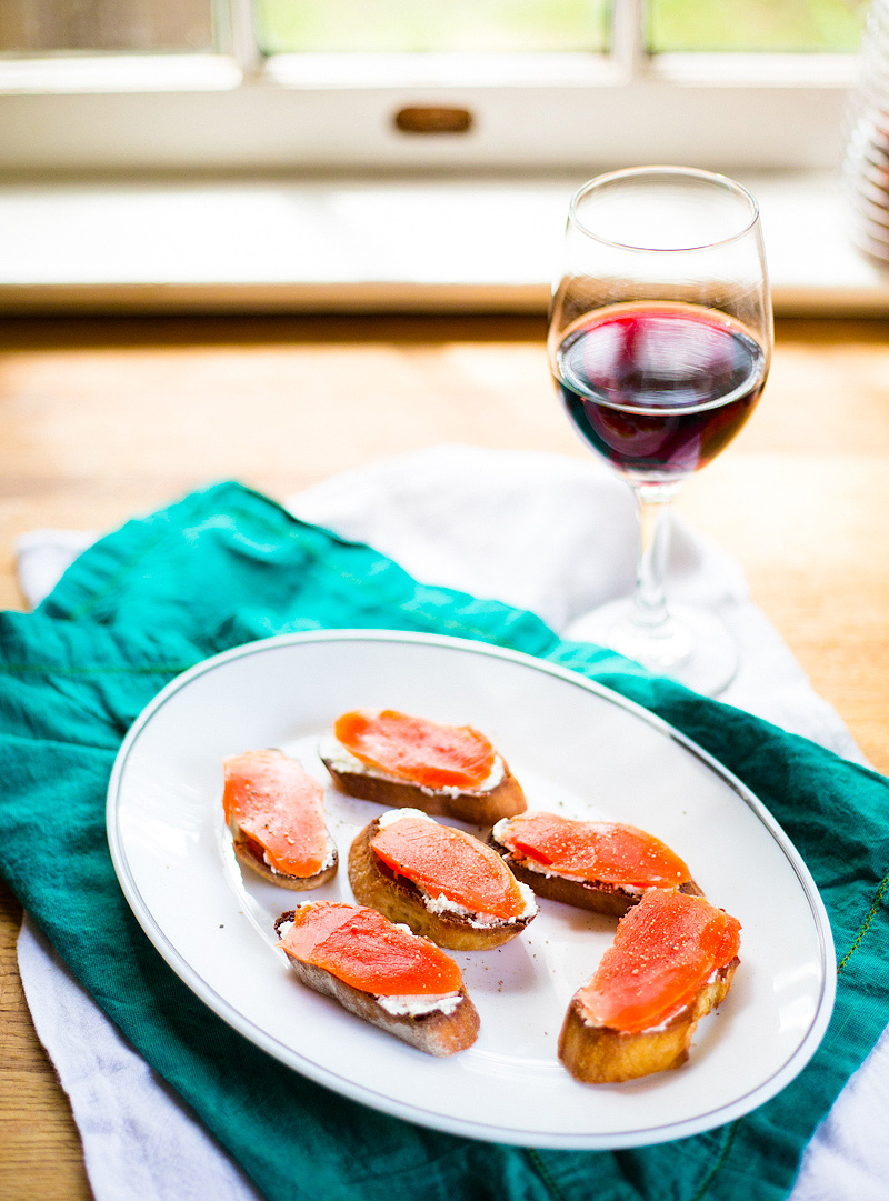 crostini with salmon and goat cheese and a glass of wine