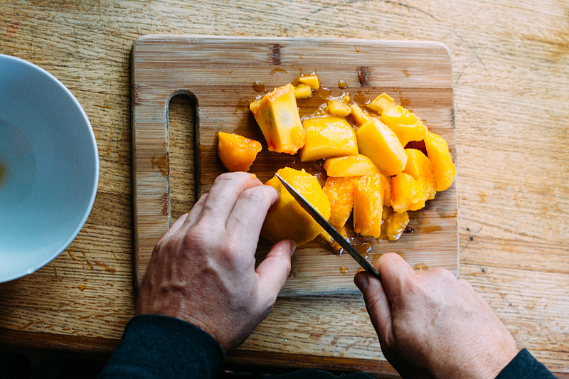 cutting peaches