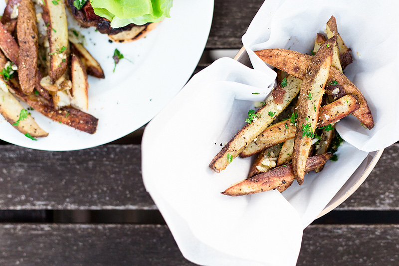 oven baked fries topped with parsley and garlic