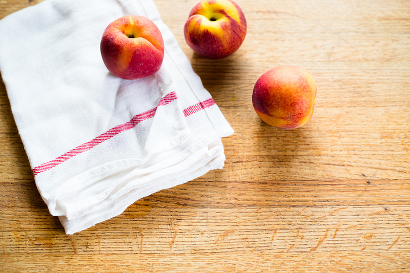 peaches and a dishcloth