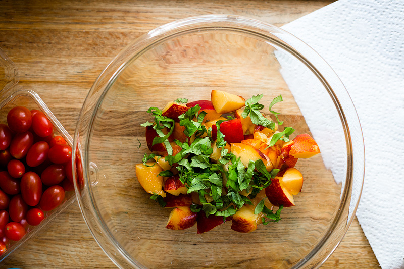 peaches and basil in a bowl