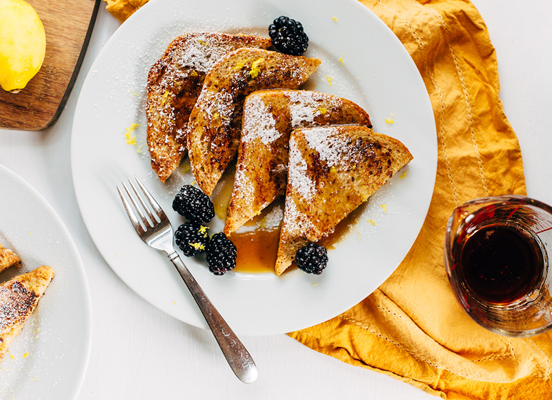 french toast for two with lemon zest and blackberries