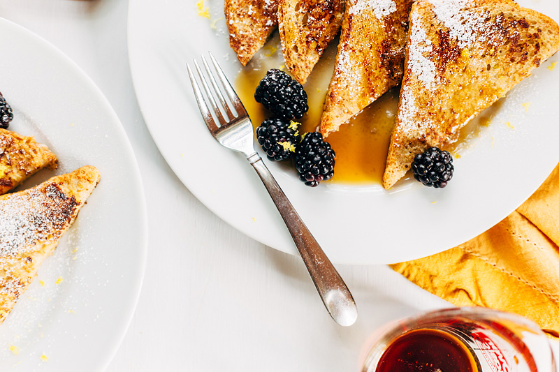 french toast for two with a fork and blackberries