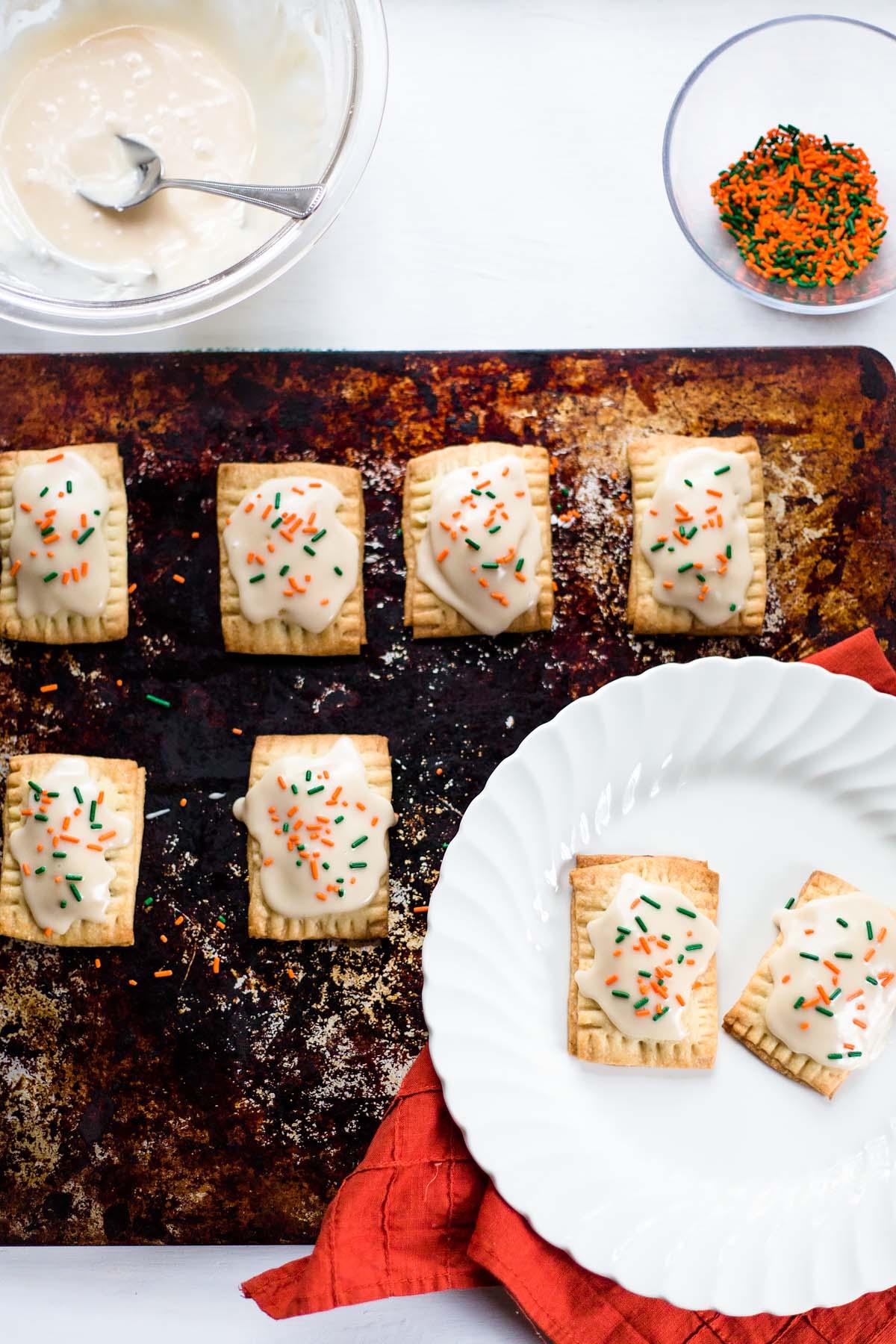 homemade pumpkin pie pop tarts with sprinkles on top