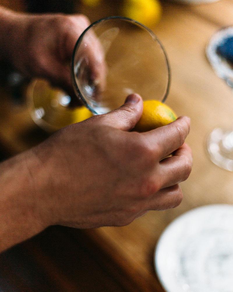 running a lemon around the rim of a martini glass