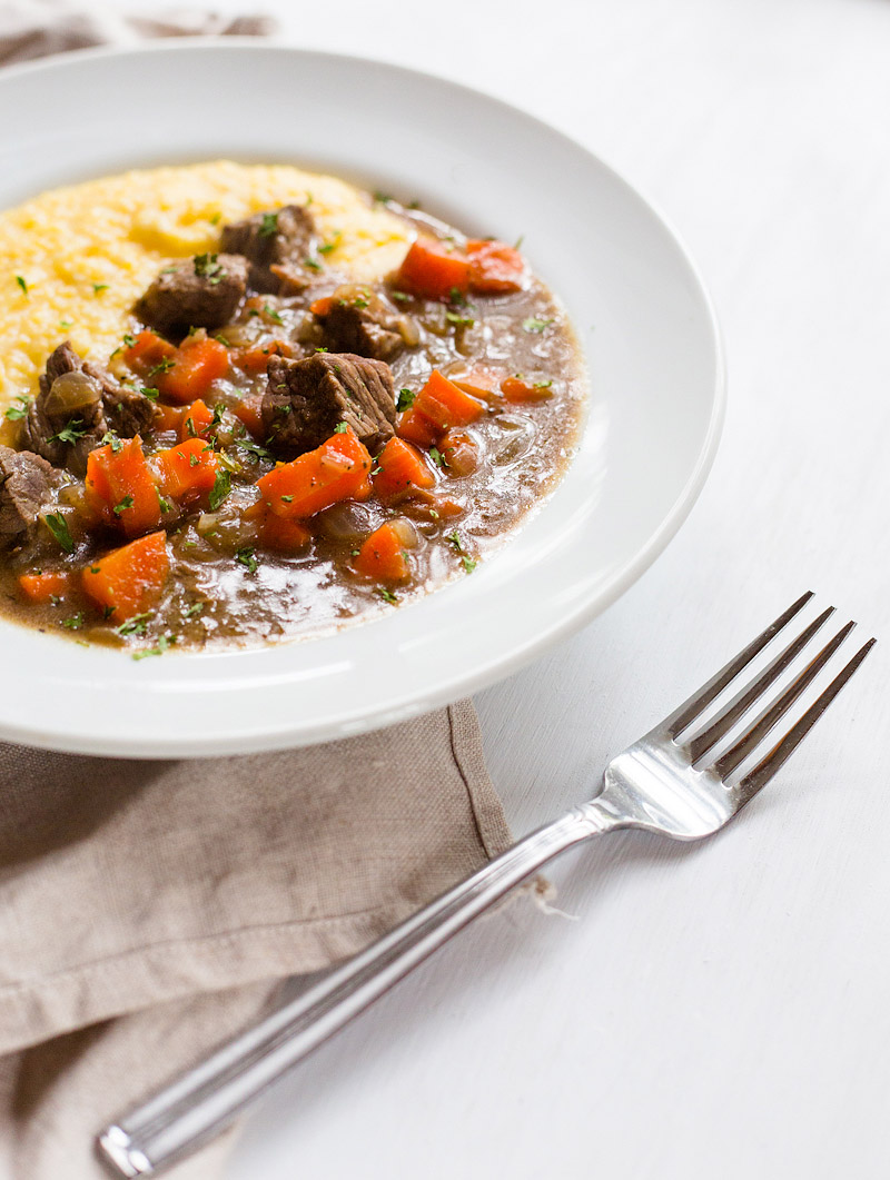 stew with parmesan polenta in a bowl