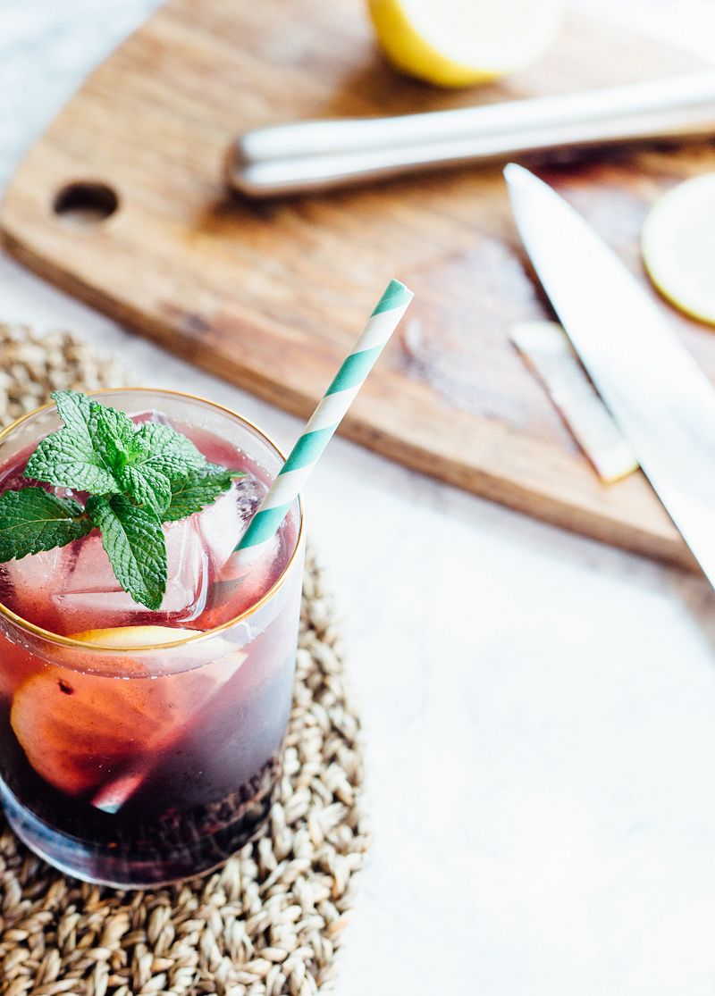 Blackberry Iced Tea with Mint and a straw