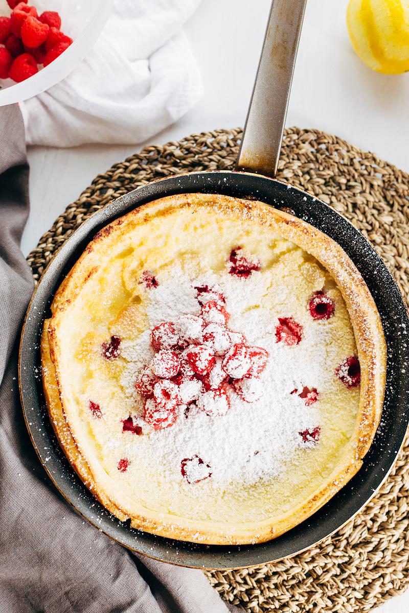 Raspberry Dutch Baby Pancake topped with fresh raspberries
