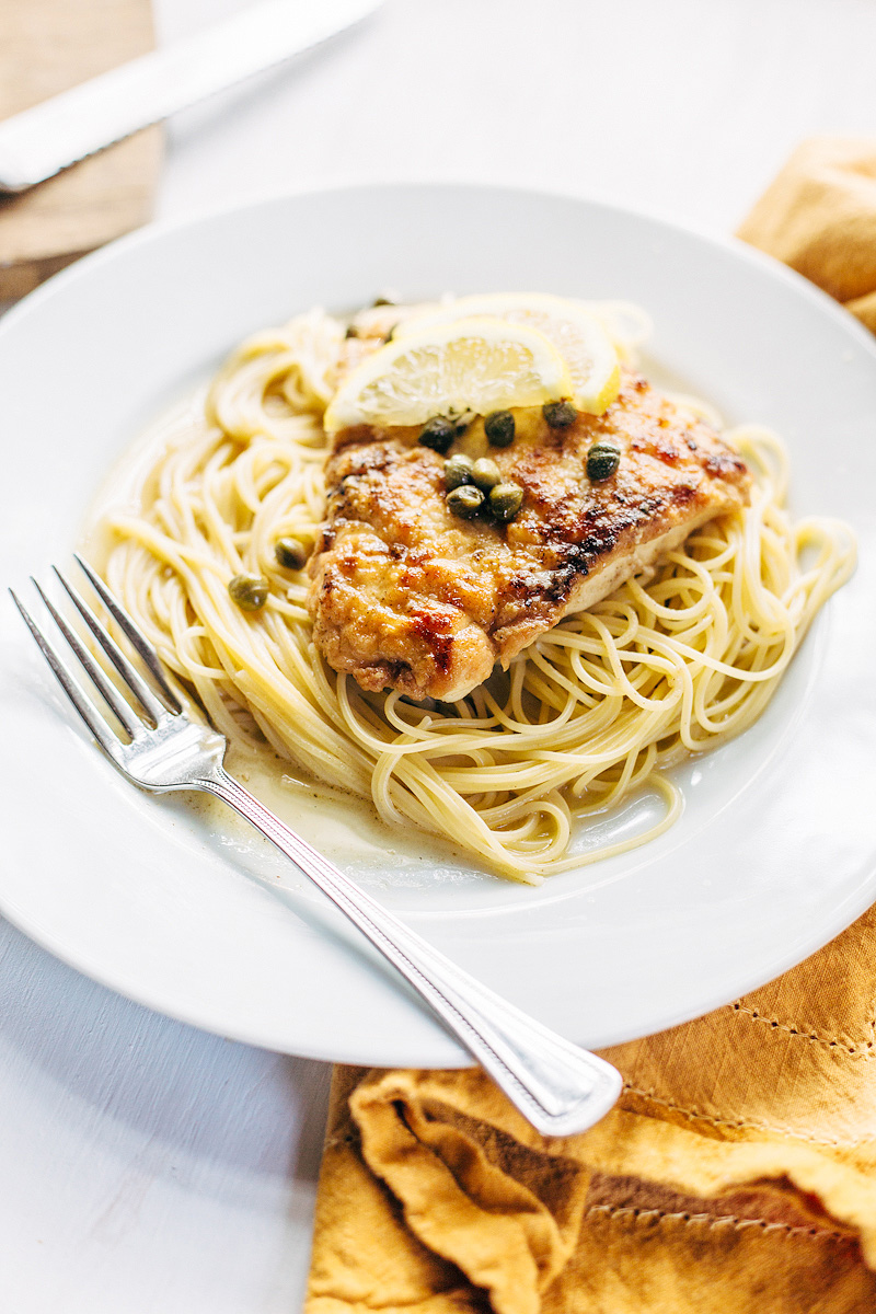 Chicken Piccata on a plate with angel hair pasta