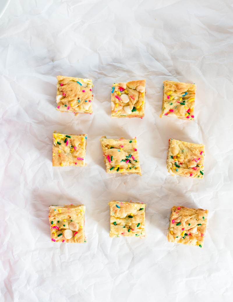 9 cookie cake bars on a sheet