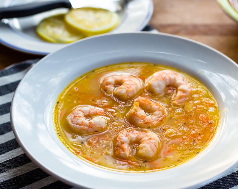 lemon orzo soup with shrimp in a bowl