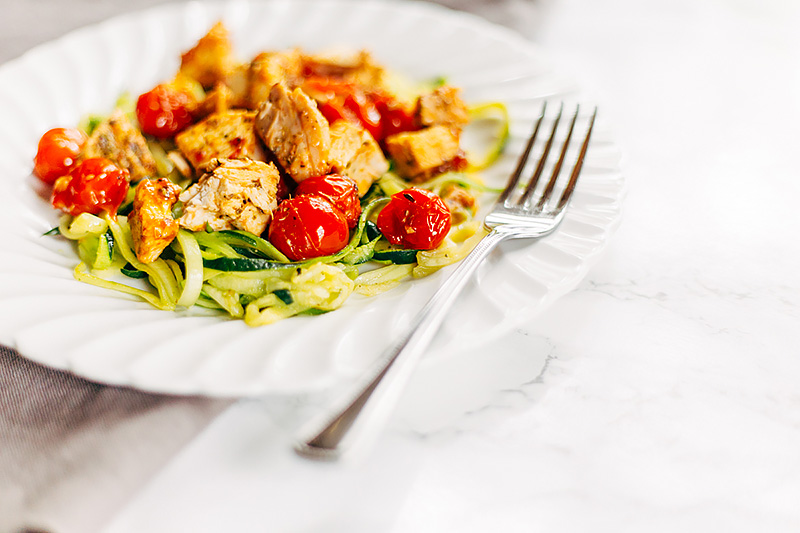 low carb Tomato Chicken Pasta with zucchini noodles on a plate with a fork