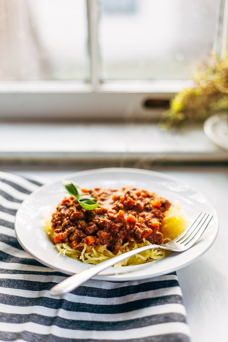 low-carb bolognese with spaghetti squash on a plate with a fork