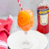 frozen aperol spritz with a bottle of aperol
