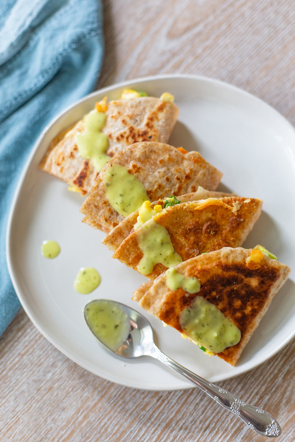 breakfast quesadilla with a spoon from above