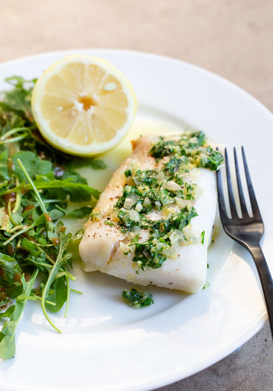 Cod with a Lemon Butter Shallot Sauce and a lemon half