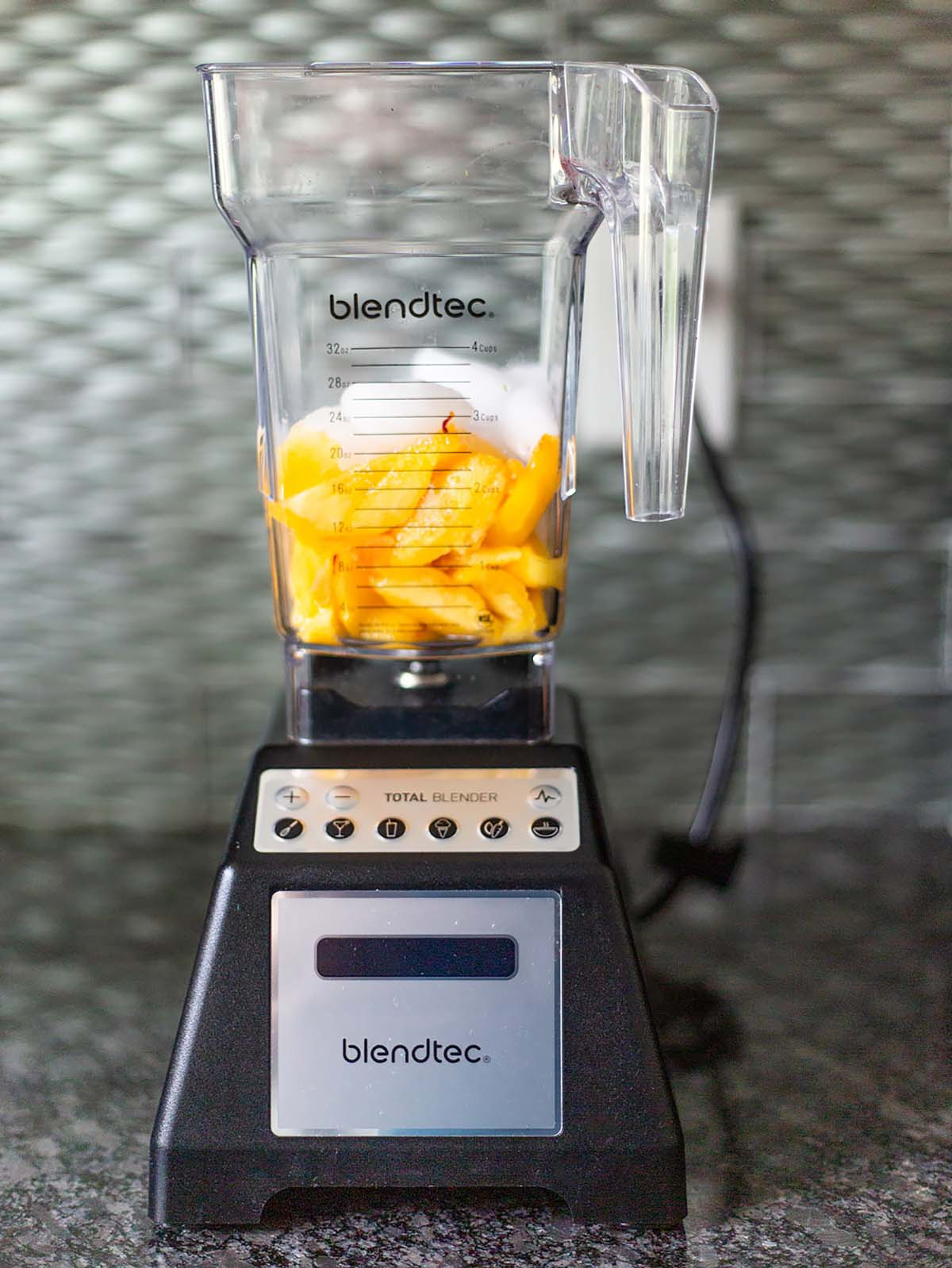 peaches and ice in a blender
