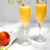 peach bellini mocktail with a peach on the side