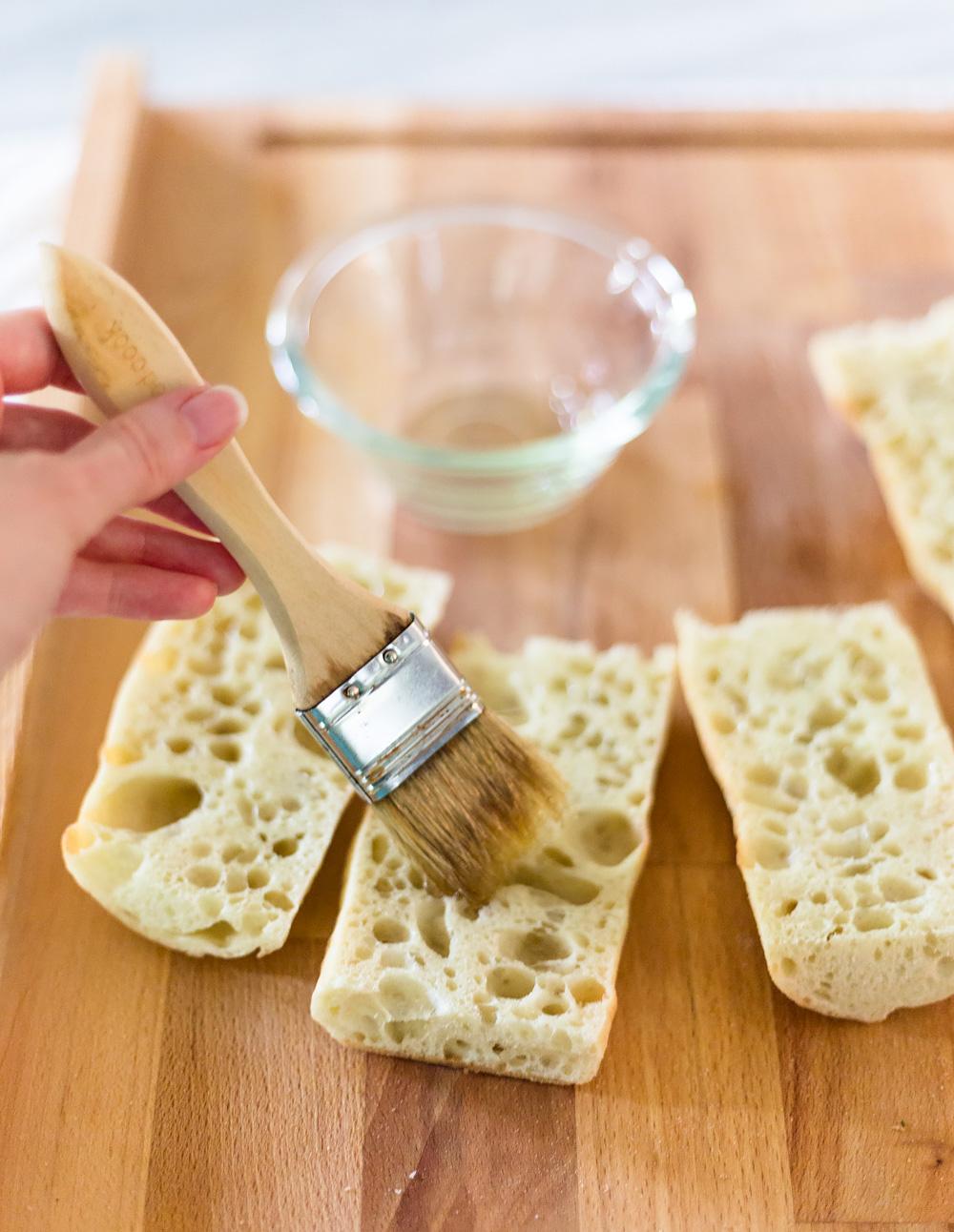spreading oil on bread