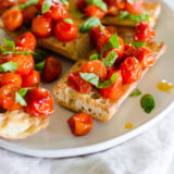 oven roasted tomatoes on toasted bread