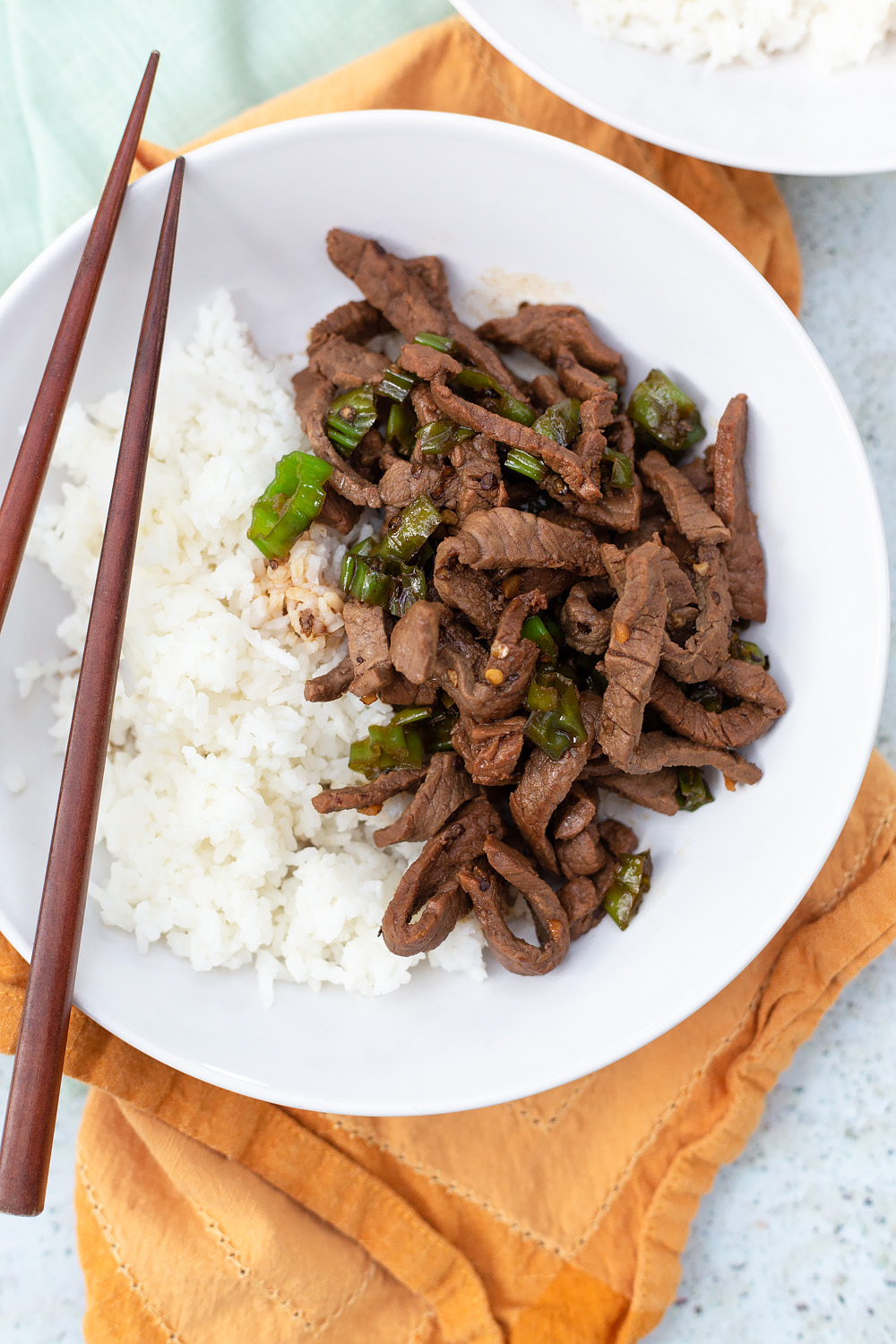 steak and shishito peppers with chopsticks