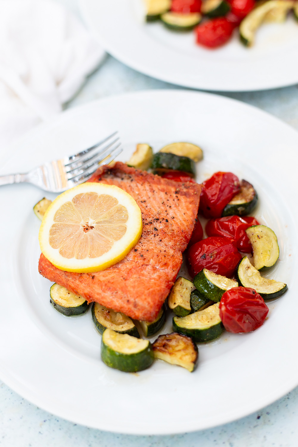 pan fried salmon with roasted veggies on a plate