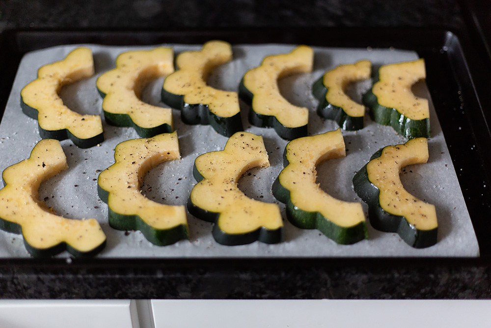 acorn squash on a sheet pan