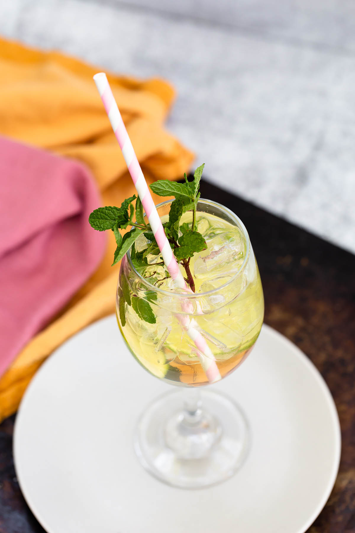 hugo cocktail with a straw