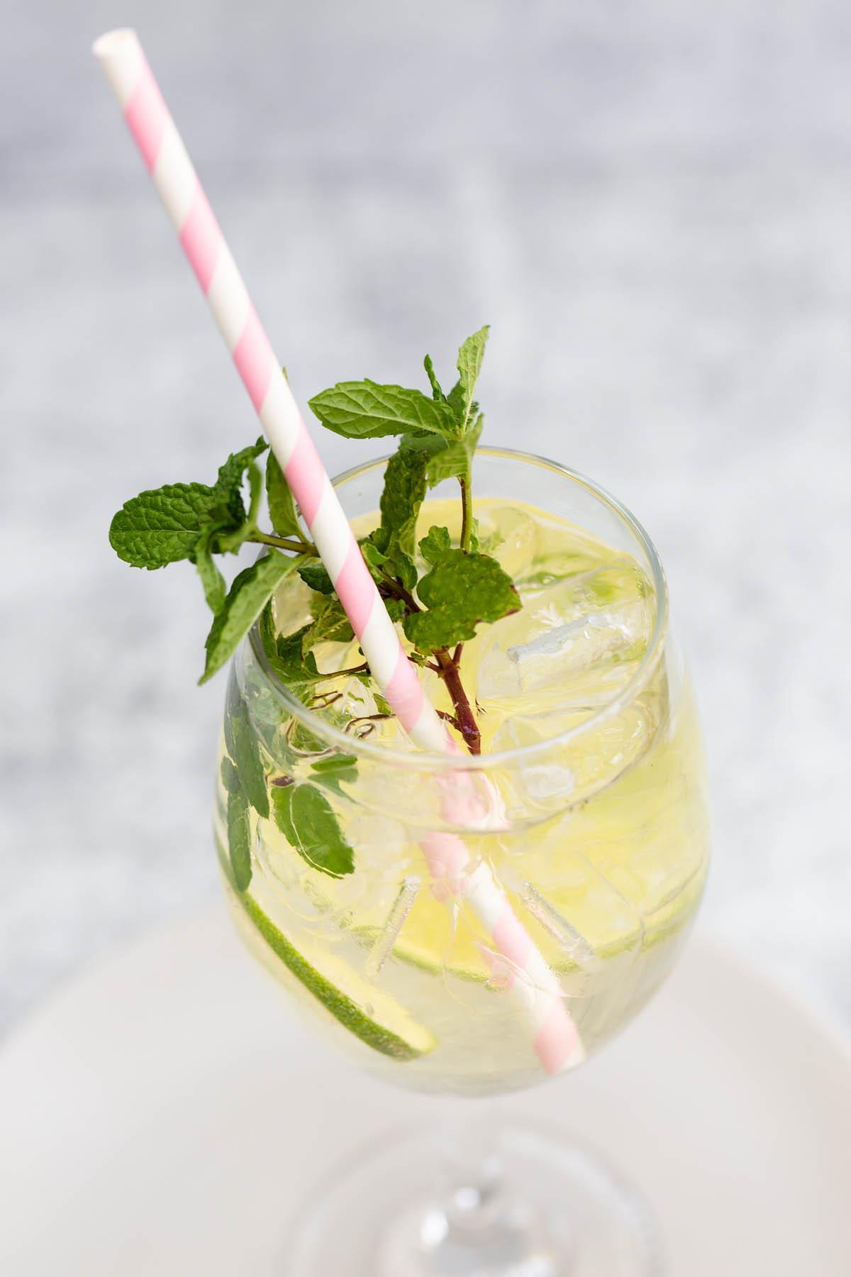 hugo spritz with a pink straw