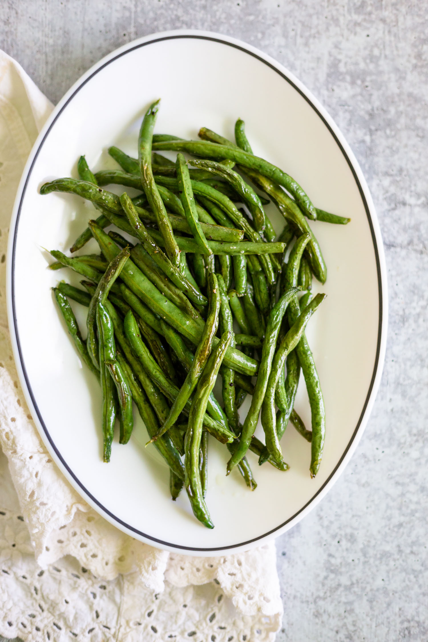 roasted green beans on a platter