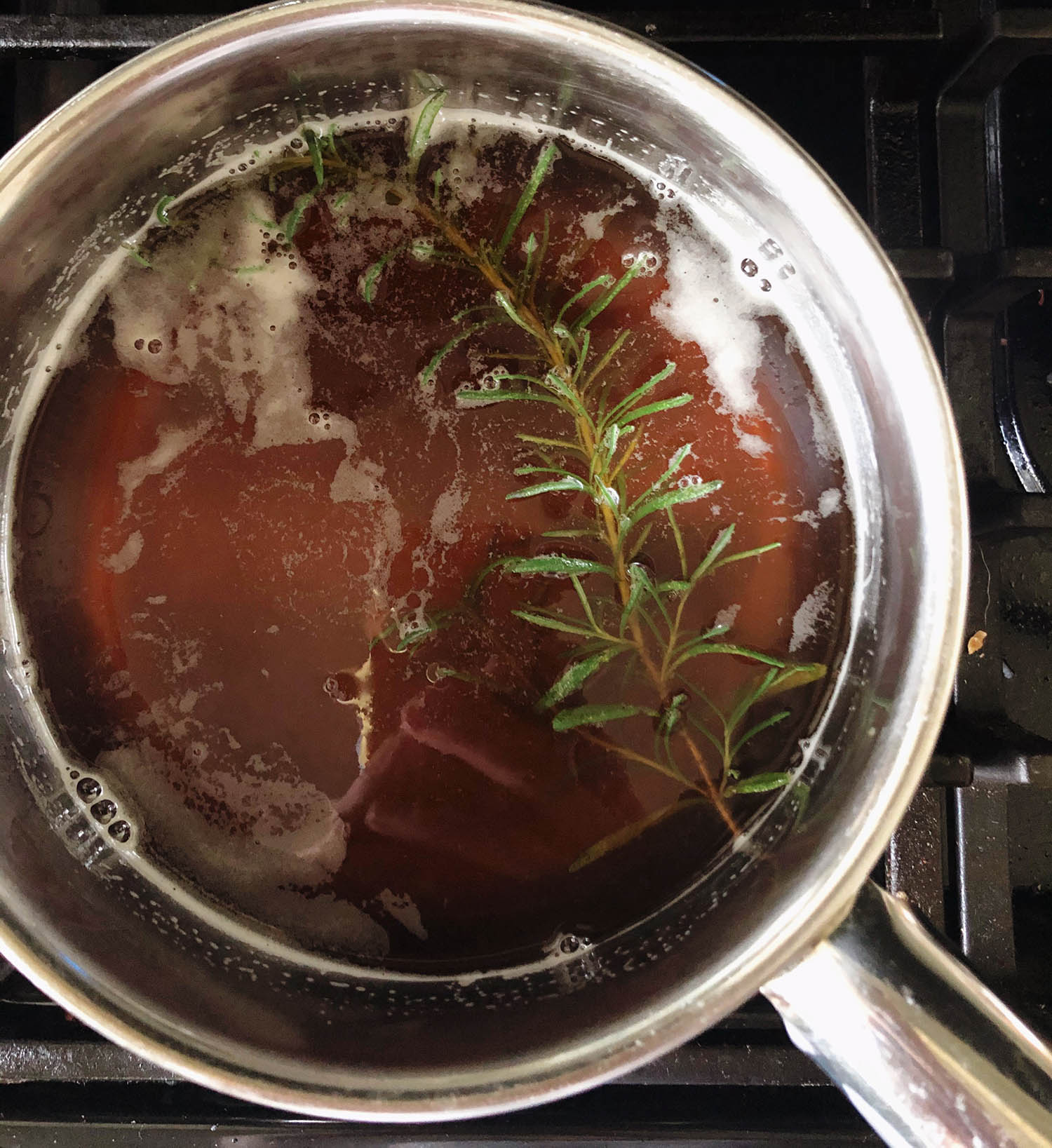 rosemary sprig in the honey syrup