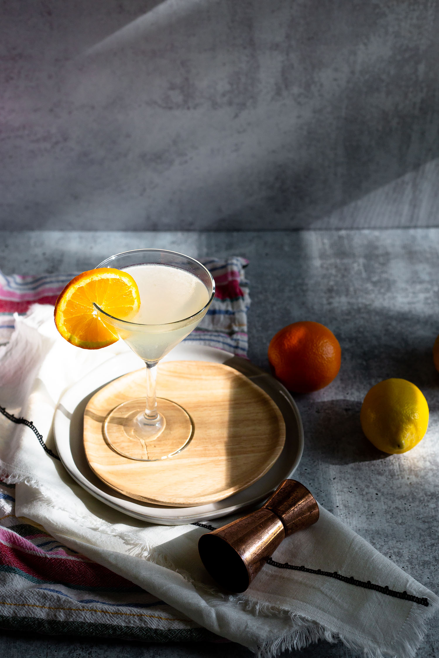 white lady cocktail with an orange slices