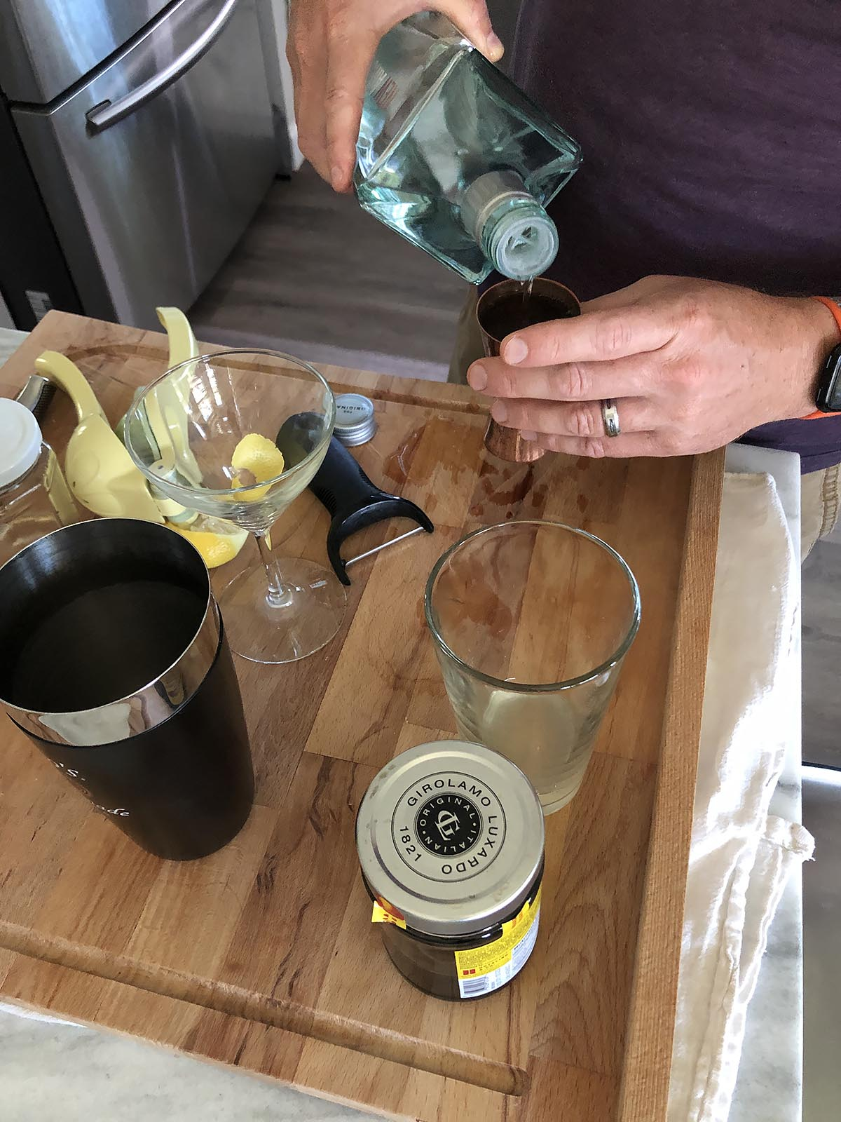 pouring gin for a cocktail