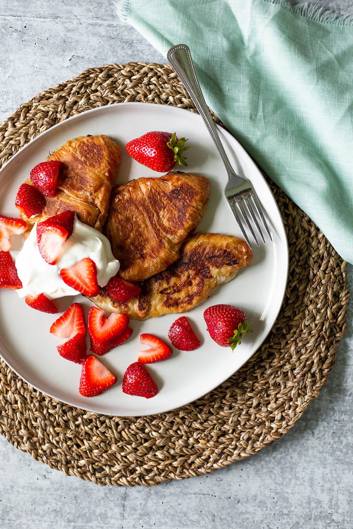 croissant french toast with strawberries and whipped cream