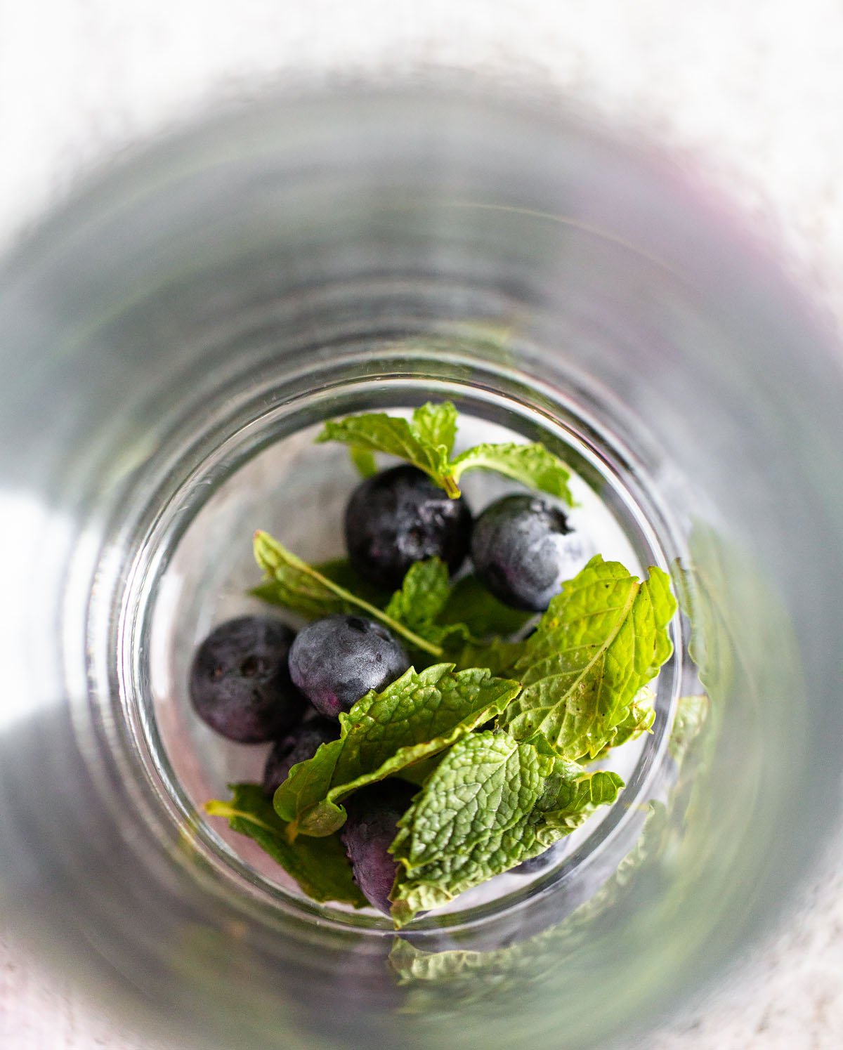 blueberries and mint in a glass