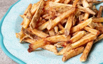 crispy battered french fries on a plate