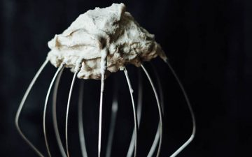 cinnamon whipped cream on a whisk