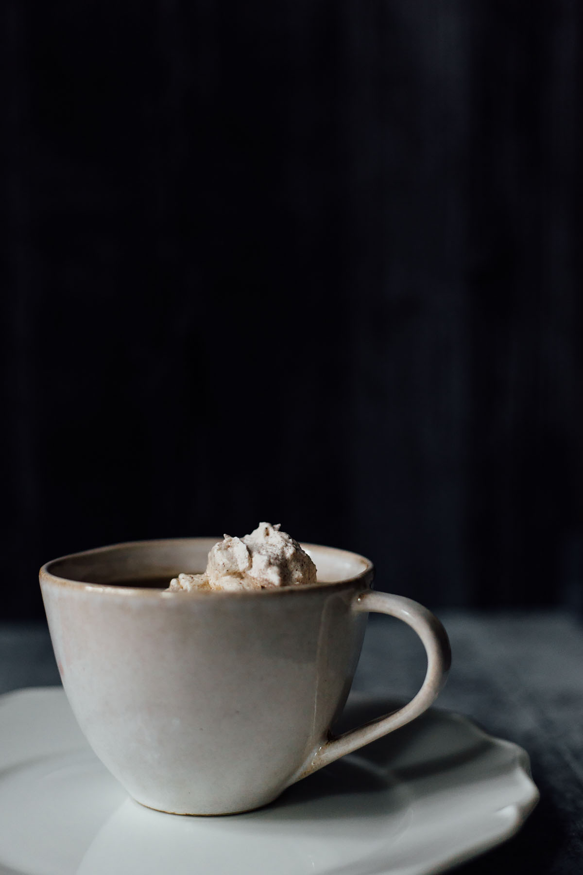 homemade cinnamon whipped cream in a coffee cup