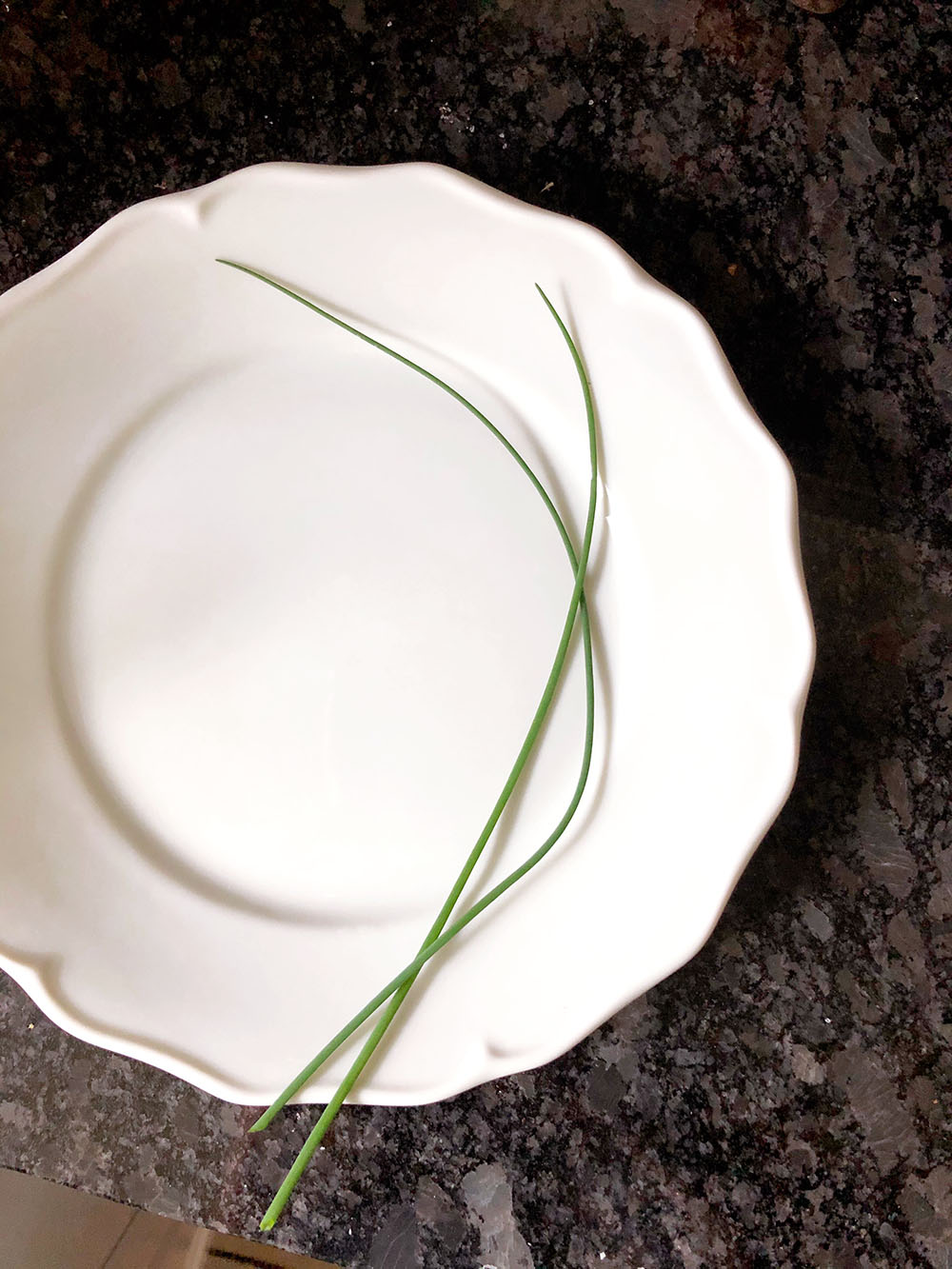 two chives on a plate