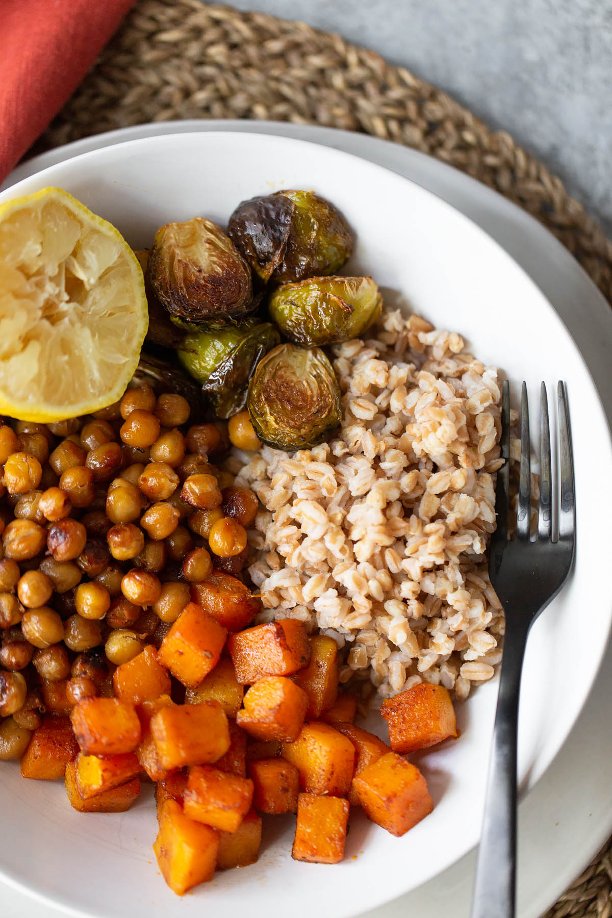 farro bowl with butternut squash chickpeas ad brussels sprouts