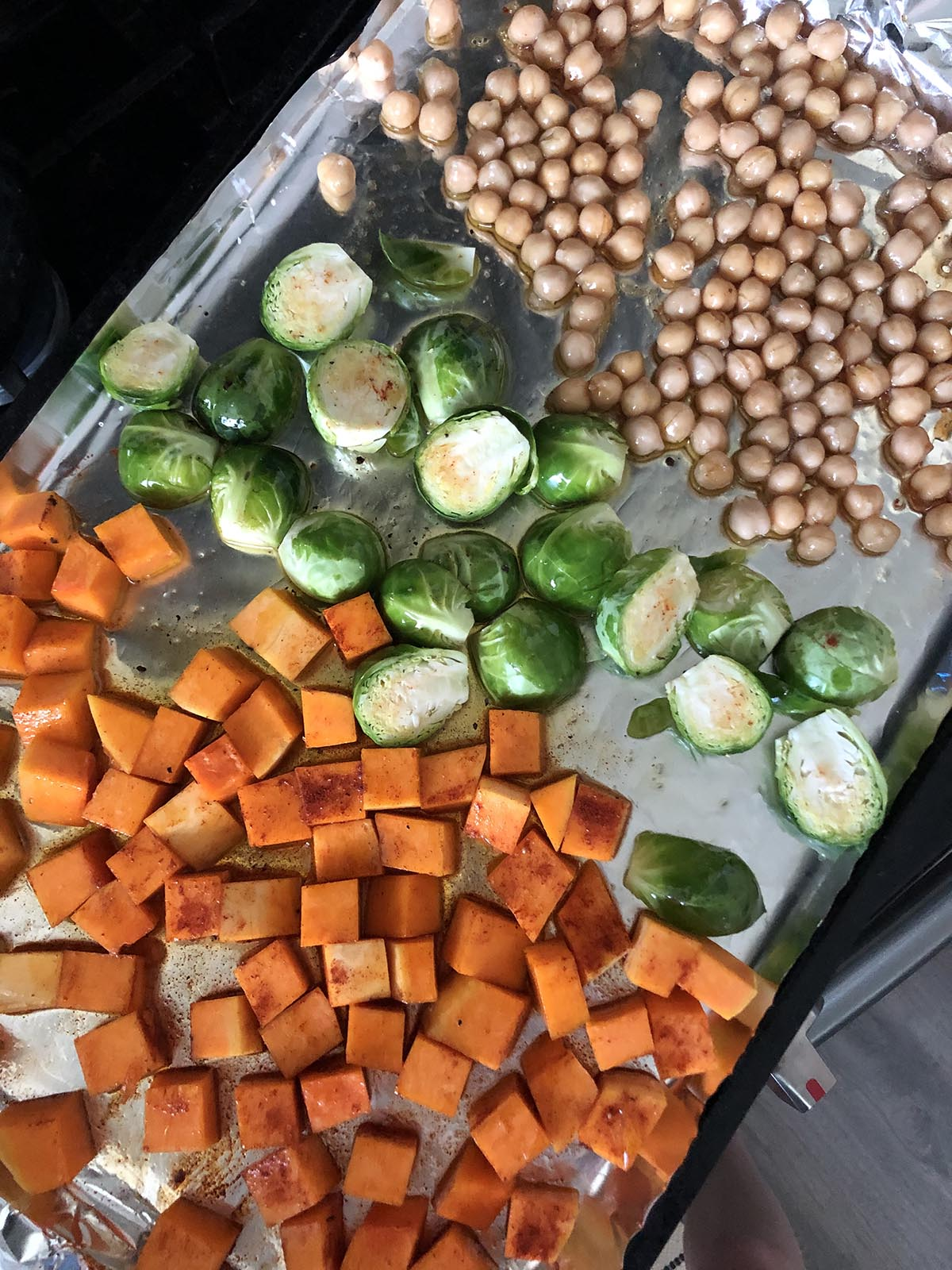 brussels sprouts chickpeas and butternut squash on a sheet pan