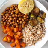 farro bowl up close with butternut squash chickpeas ad brussels sprouts