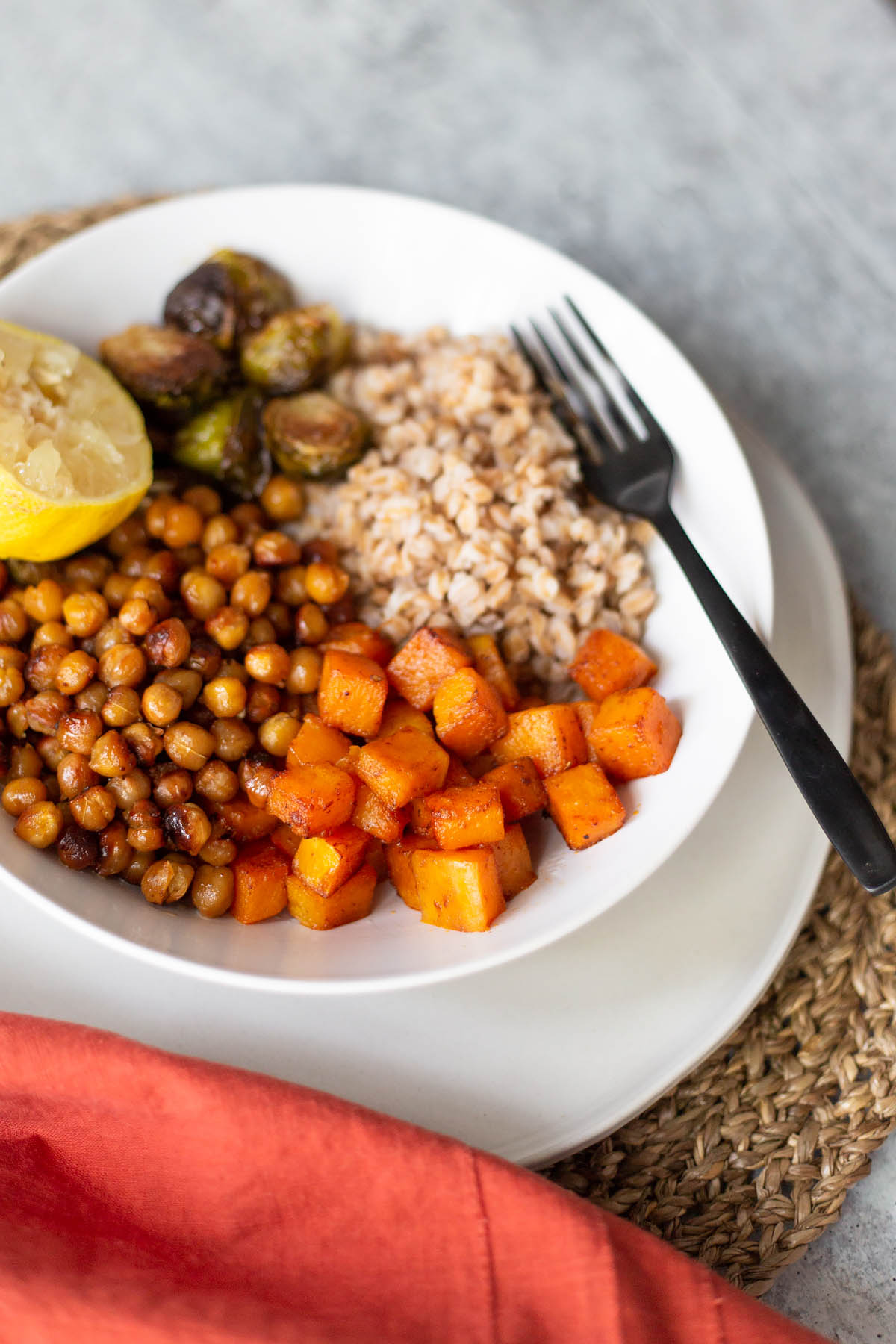 butternut squash farro bowl with a fork