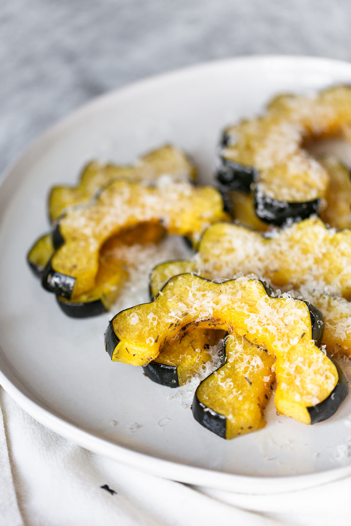 oven roasted acorn squash slices with parmesan cheese
